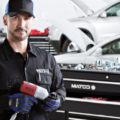 Matco employee with portrait by Barney Taxel