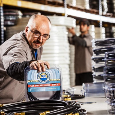 Commercial and product photographer Barney Taxel captures the Fuel Tank Feed Hose by Marine Products International.